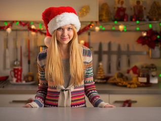 Portrait of young woman in christmas decorated kitchen