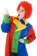 Clown zu Fasching zeigt mit Zeigefinger