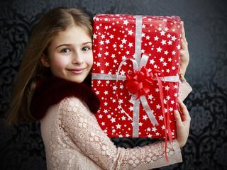 Christmas gift - lovely girl with christmas present