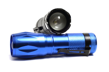 two compact flashlight on a white background
