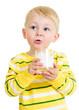 Pretty kid drinking milk from glass