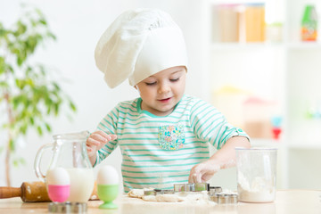 little baker kid girl in chef hat