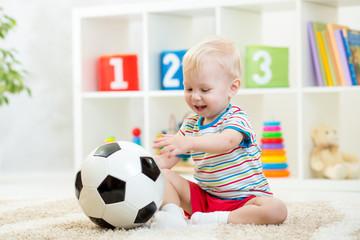 kid boy with football  indoor