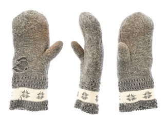 Old gray frayed mitten isolated