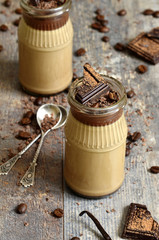 Chocolate coffee pannacotta in a glass jar.