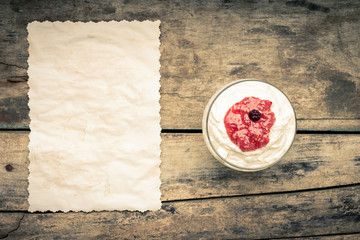 Dairy sweet dessert with raspberry jam and Fresh blueberry