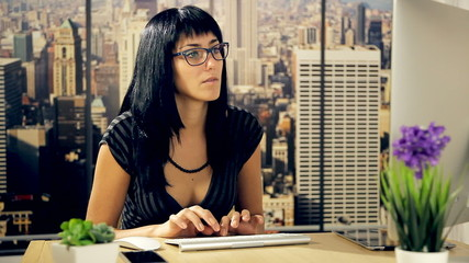 Young beautiful woman working in office in New York