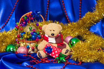 Charming small teddy bear with Christmas gift