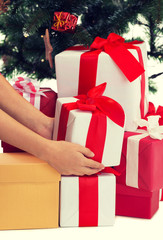 close up of woman with presents and christmas tree