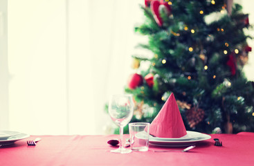 room with christmas tree and decorated table