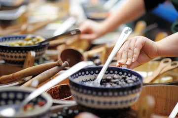 Many bowls of olives at the farmer's market