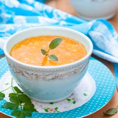 pumpkin soup in a blue bowl