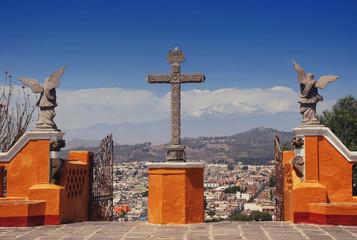Cholula Pyramid in Puebla, Mexico. City and Popocatepetl volcano