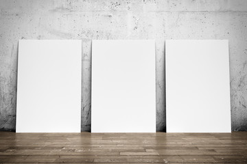 White poster on concrete wall and wood floor