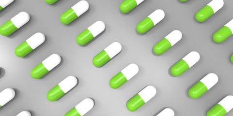 white and green color pills on grey gray background