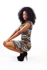 African American Teen Girl Squatting In Dress