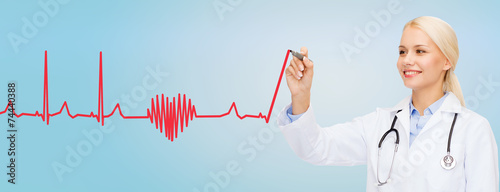 smiling female doctor drawing heartbeat cardiogram