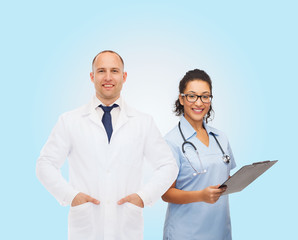 smiling doctors with clipboard and stethoscopes