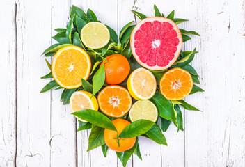 Citrus fruits heart on white wood background