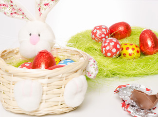 Decorated Easter bunny basket with chocolate eggs