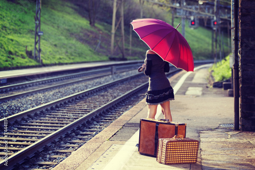 Woman waiting for the train at the station - 74441114