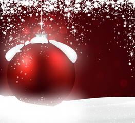 Red bauble over winter background.