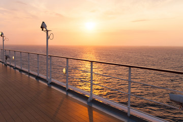 deck of a cruise ship at sunrise