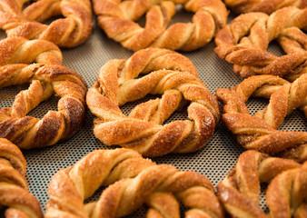 fresh pretzel on a baking sheet
