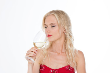 nordic girl smelling a glass of white wine