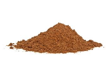 Nutmeg powder on a white background