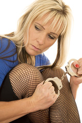woman black fishnets hold handcuffs look side