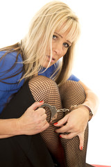 woman back fishnets hold handcuffs look serious
