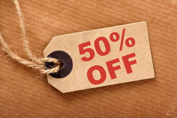 Fifty percent off announcement on a sales price tag