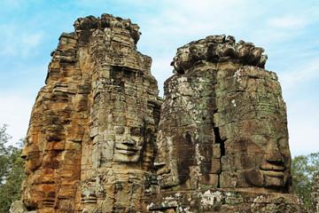 Lächelnde Gesichter des Bayon Tempels