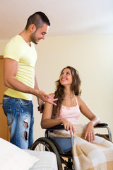 Social worker with woman in wheelchair