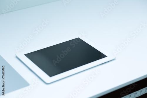 canvas print picture Tablet Computer auf weißer Unterlage