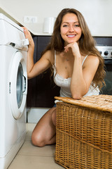 Housewife using washing machine