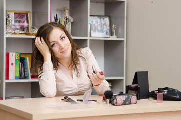 Girl in the office chooses lipstick
