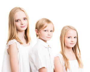 Two Sisters And Their Brother Dressed in White in the Studio