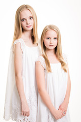 Two Beautiful Blond Teenage Girls Dressed in White.