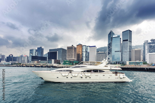 Plakat yacht,cityscape and victoria harbor of  hongkong