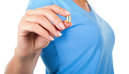 Closeup picture of woman with Omega 3 fish oil capsule