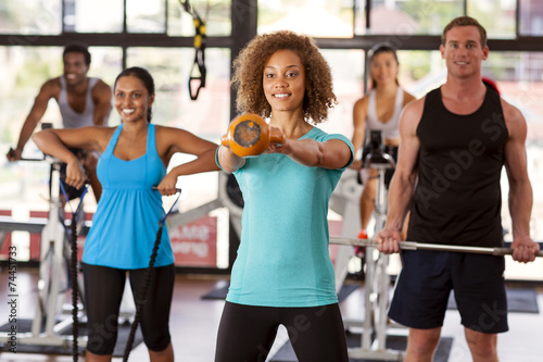 Tuinposter Gymnastiek Group exercising in a gym