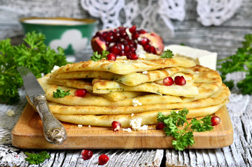 Flat cake with filling from potato,brynza and herbs.