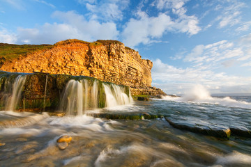 Waterfall on Monknash beach in Glamorgan, Wales, UK.