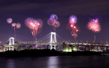 Fireworks celebrating over Tokyo Rainbow Bridge at Night, Japan