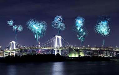 Fireworks celebrating over Tokyo Rainbow Bridge at Night, Japan