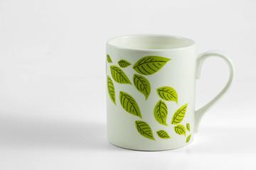 Tazza con foglie di te