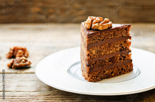 Fototapeta chocolate cake with walnuts
