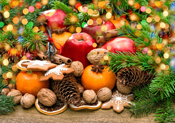 Fruits, christmas cookies and spices with wonderful lights